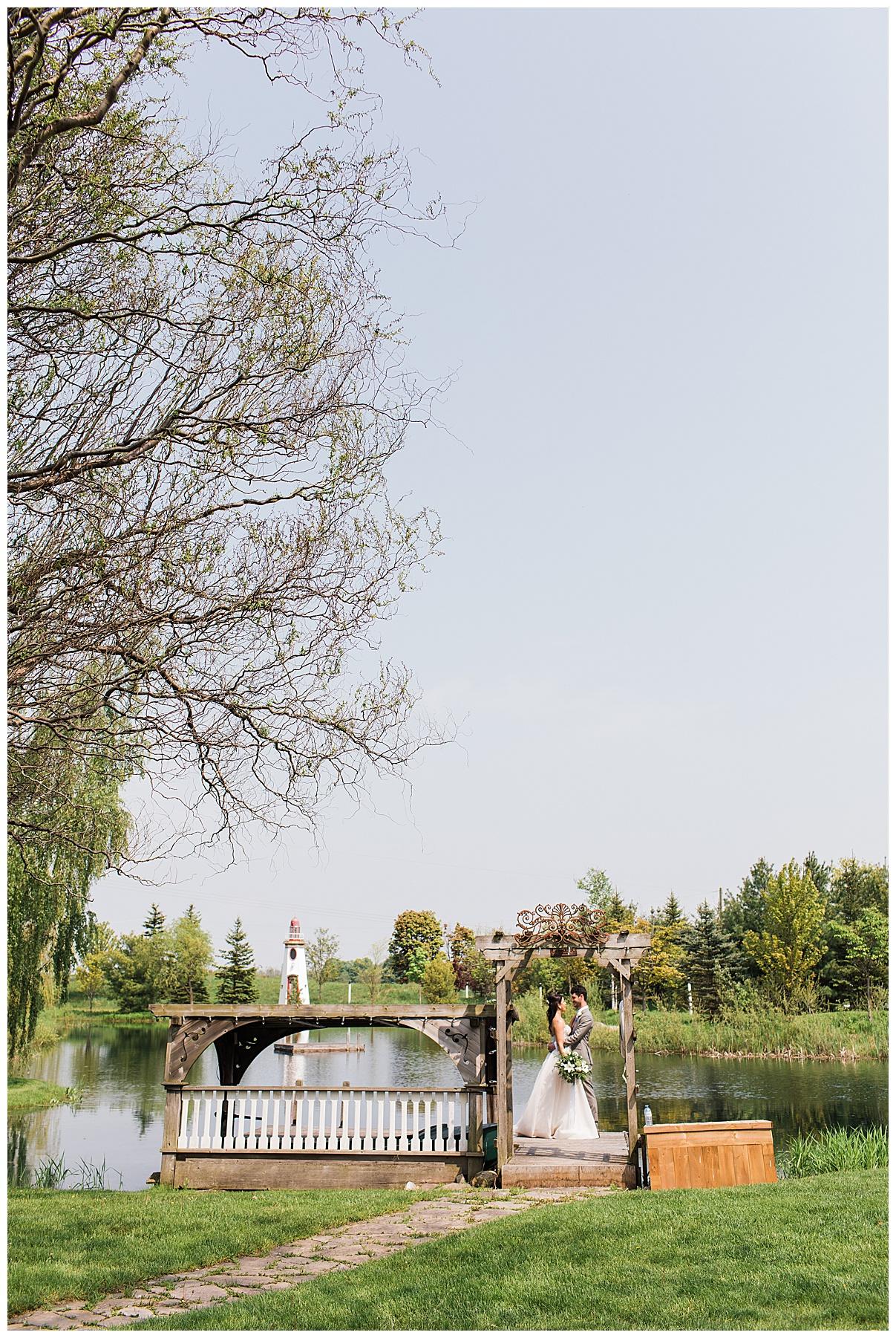 Bride and groom stand on dock | Belcroft Estate Wedding| Toronto wedding photographer| Ontario wedding photographer| 3photography