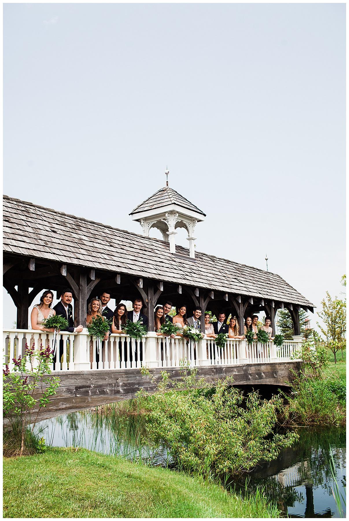 Bridal party leaning out over beautiful bridge|  Belcroft Estate Wedding| Toronto wedding photographer| Ontario wedding photographer| 3photography