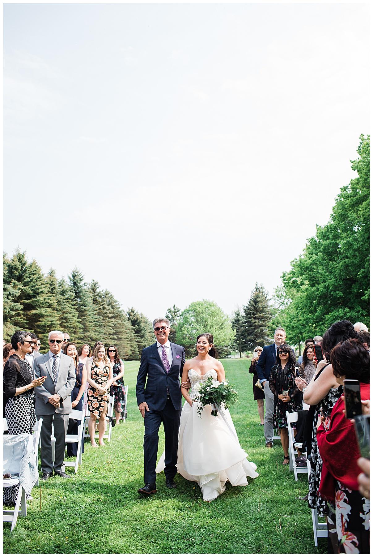 Bride walks down aisle with father| outdoor tree-farm ceremony| Belcroft Estate Wedding| Toronto wedding photographer| Ontario wedding photographer| 3photography