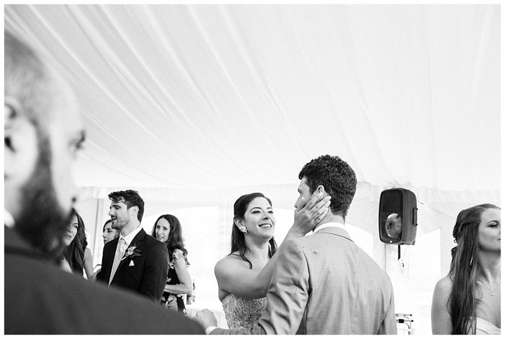 Black and white shot of bride holding grooms face between her hands at wedding reception| Belcroft Estate Wedding| Toronto wedding photographer| Ontario wedding photographer| 3photography
