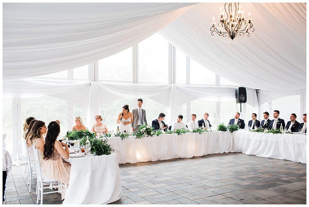 Bride and groom standing to give toast| Wedding reception tent| Outdoor wedding | Belcroft Estate Wedding| Toronto wedding photographer| Ontario wedding photographer| 3photography