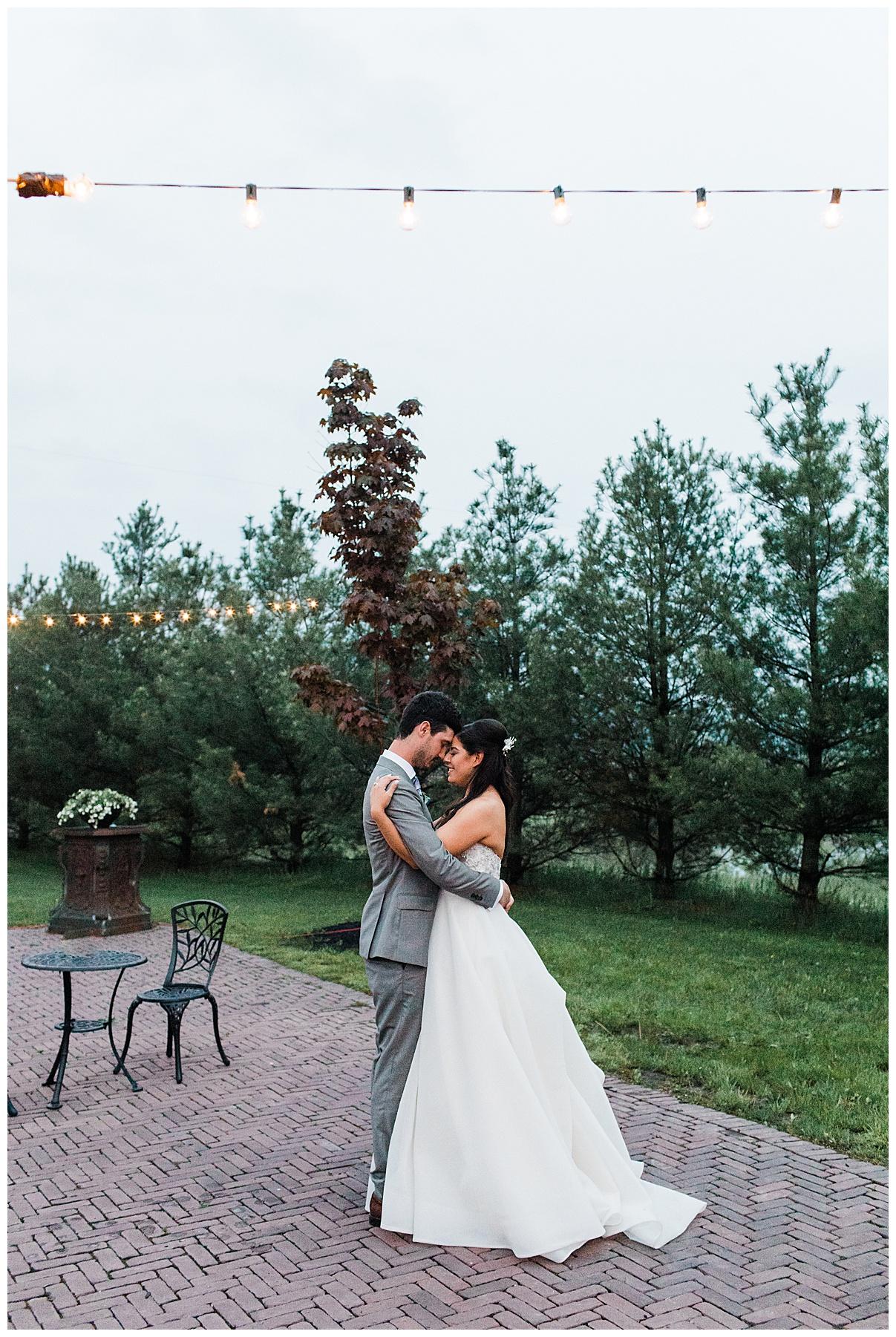 Bride and groom slow dance outside under string lights| Outdoor wedding| Belcroft Estate Wedding| Toronto wedding photographer| Ontario wedding photographer| 3photography