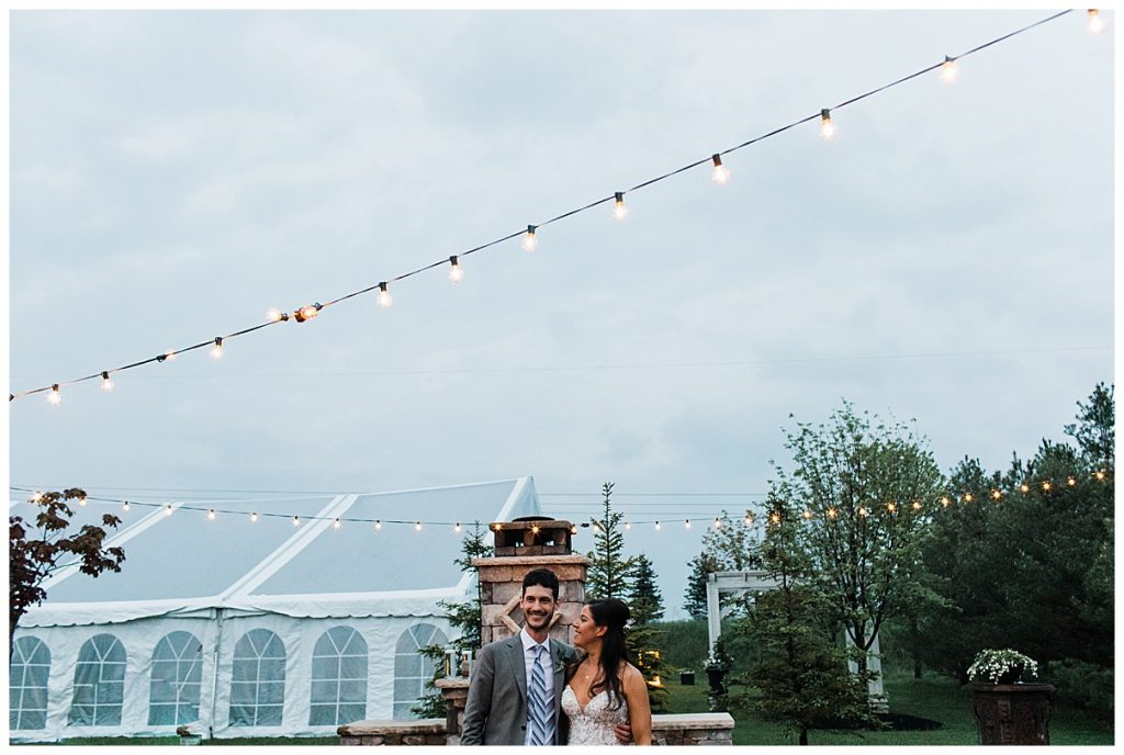 Bride and groom stand side by side under string lights| Outdoor wedding| Belcroft Estate Wedding| Toronto wedding photographer| Ontario wedding photographer| 3photography