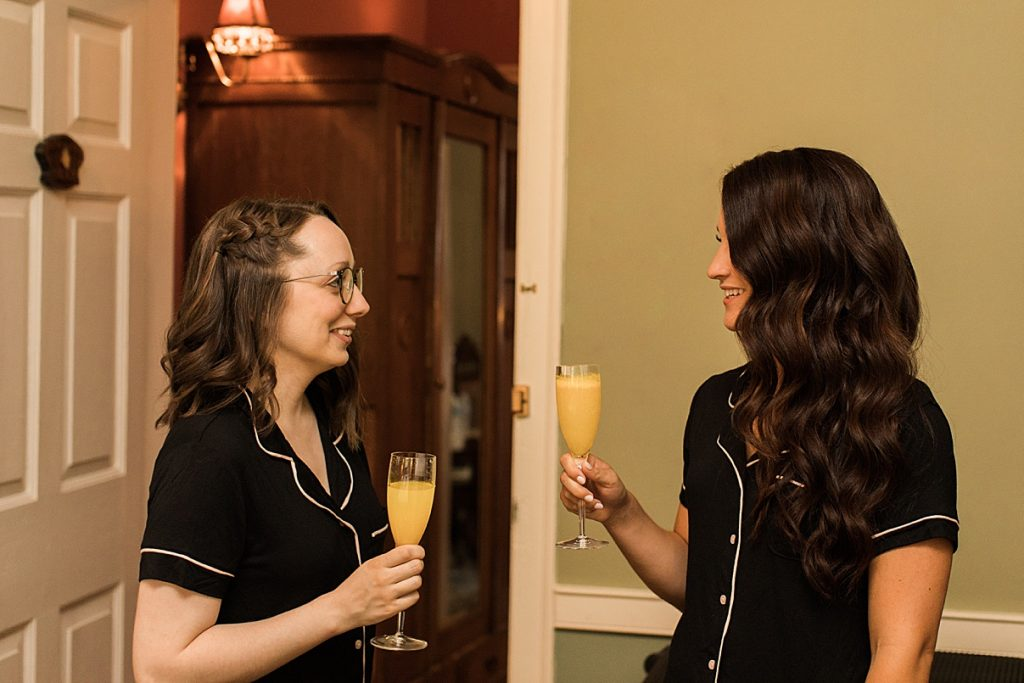 Bride and bridesmaid having a drink while getting ready| Hollie and Brian| Balls Falls, Ontario Wedding| Ontario Wedding Photographer| Toronto Wedding Photographer| 3Photography|3photography.ca
