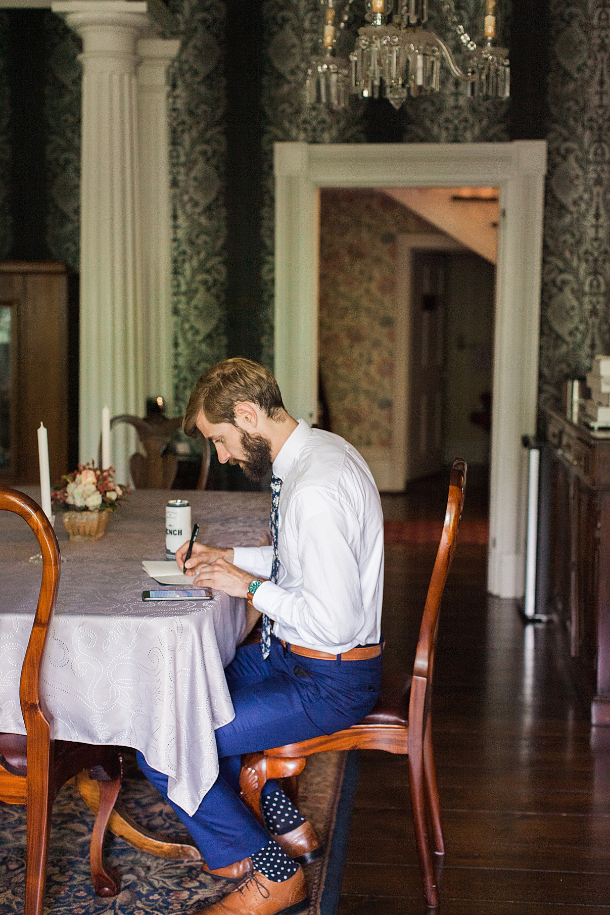 Groom sitting and writing vows at table | Balls Falls, Ontario Wedding| Ontario Wedding Photographer| Toronto Wedding Photographer| 3Photography|3photography.ca