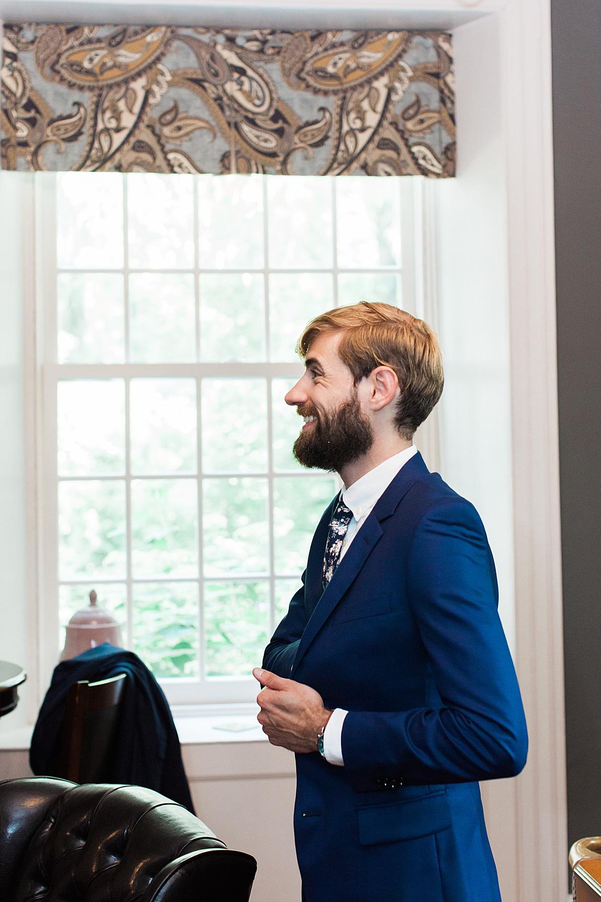 Groom grinning while getting ready | Balls Falls, Ontario Wedding| Ontario Wedding Photographer| Toronto Wedding Photographer| 3Photography|3photography.ca