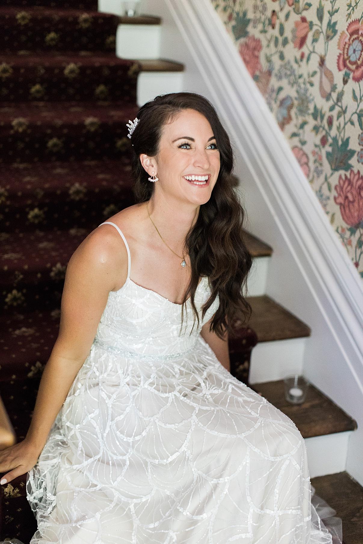 Bride smiling on stairs| Balls Falls, Ontario Wedding| Ontario Wedding Photographer| Toronto Wedding Photographer| 3Photography|3photography.ca