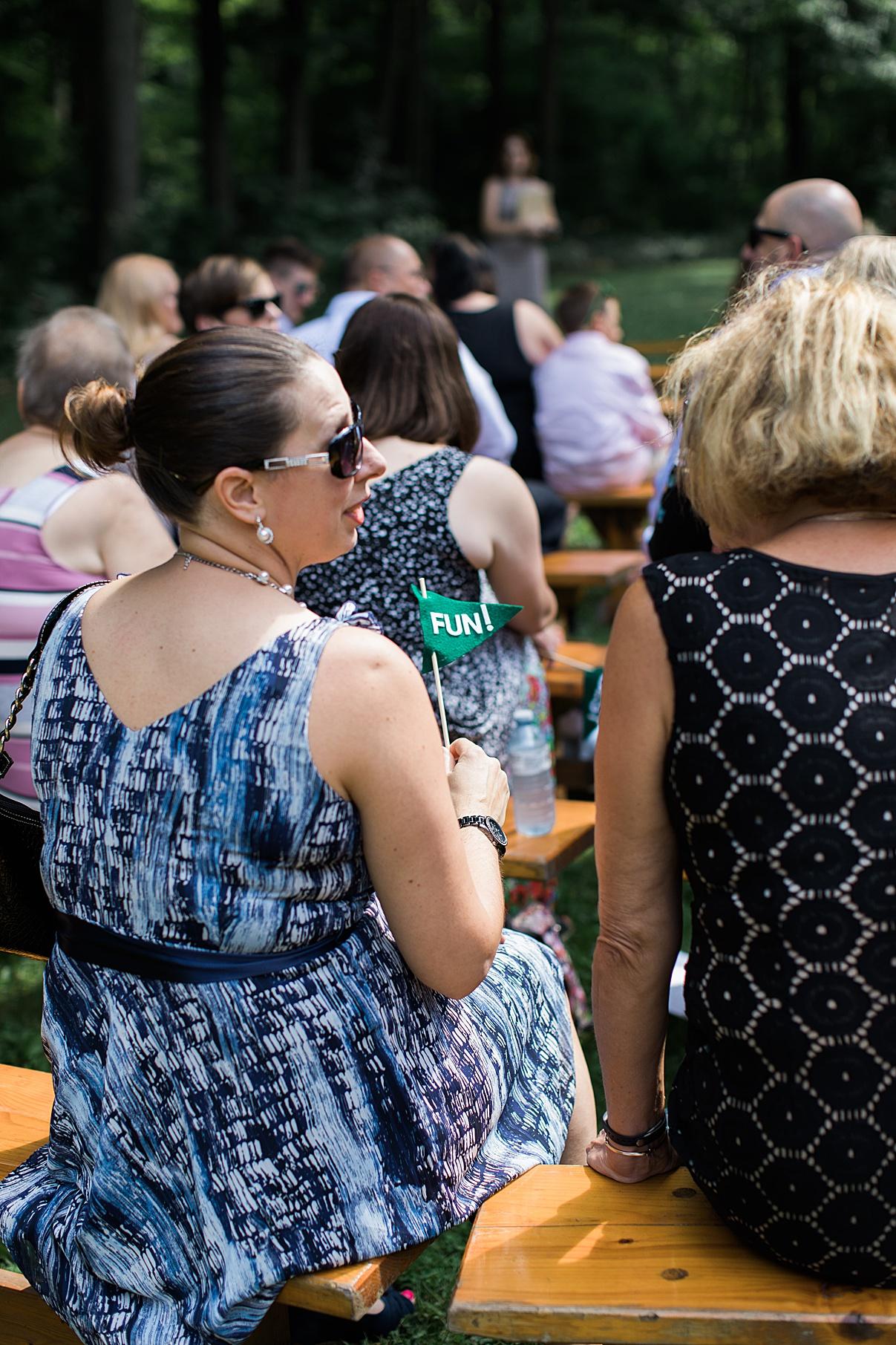Guest holding fun flag at Balls Falls Ontario Wedding  Balls Falls  Ontario Wedding  Ontario Wedding Photographer  Toronto Wedding Photographer  3Photography   3photography.ca