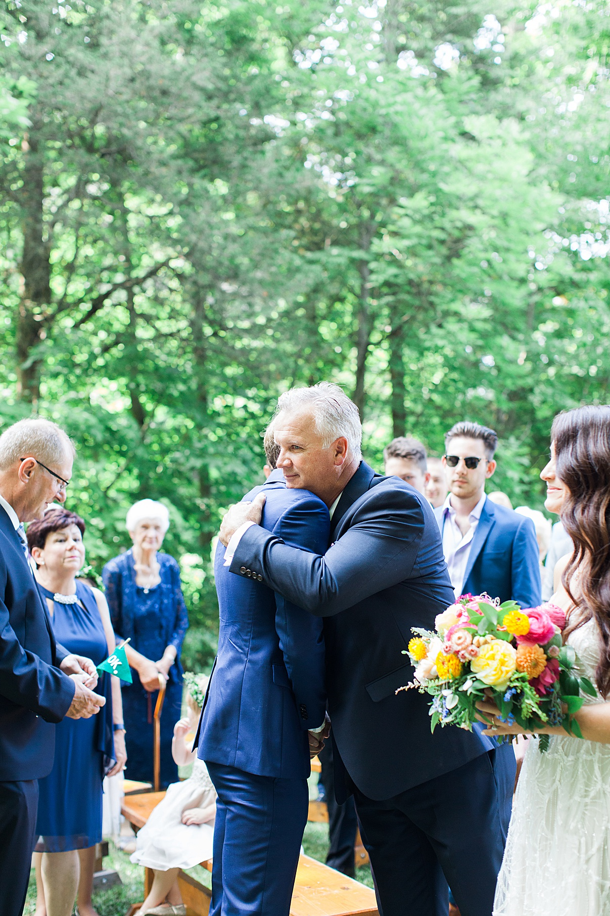 Groom hugs father of the bride at Balls Falls Wedding|Hollie and Brian| Balls Falls, Ontario Wedding| Ontario Wedding Photographer| Toronto Wedding Photographer| 3Photography| 3photography.ca