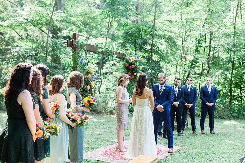 Groom and bride read vows to each other at alter | Balls Falls, Ontario Wedding| Ontario Wedding Photographer| Toronto Wedding Photographer| 3Photography| 3photography.ca
