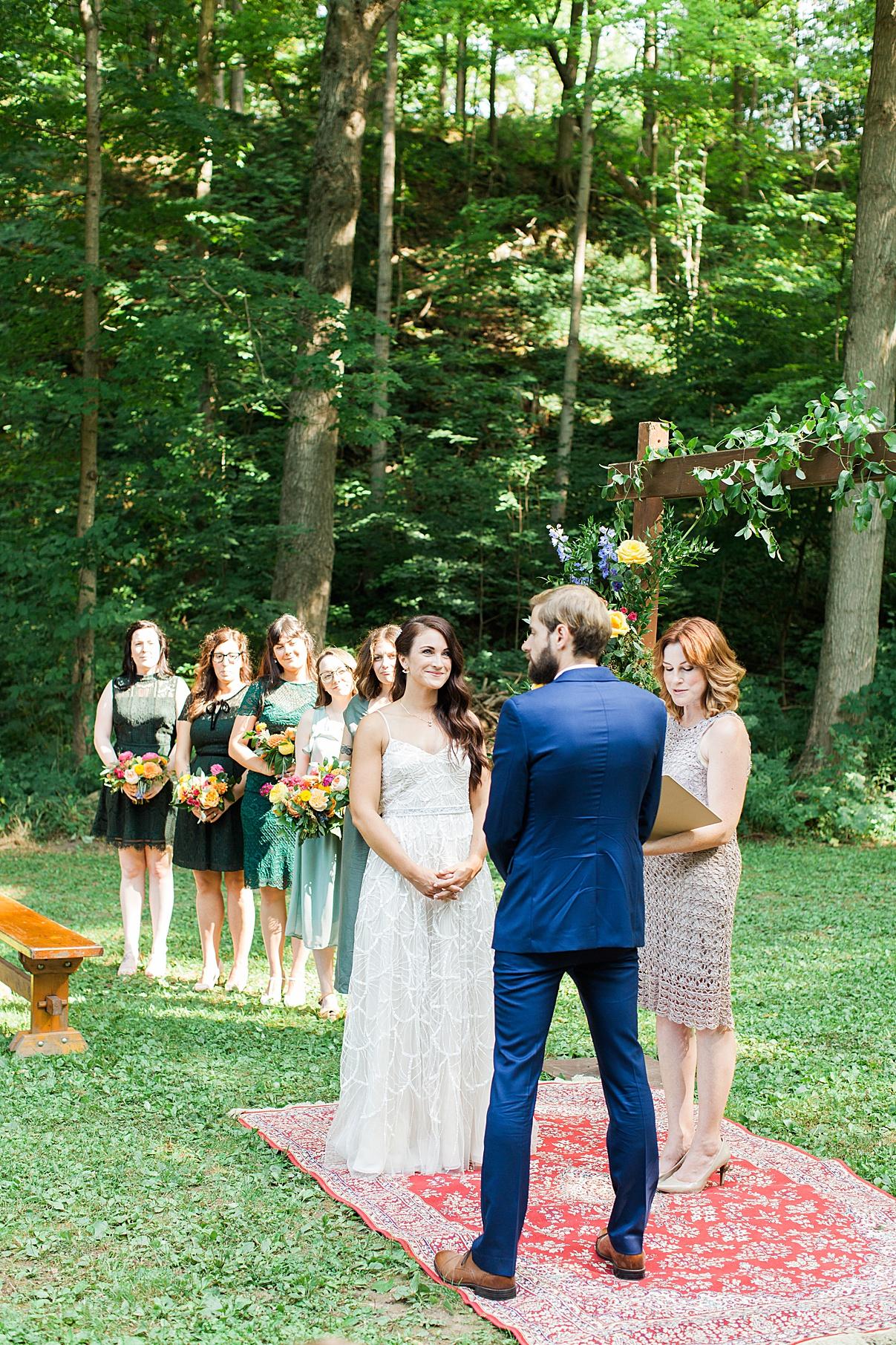 Bride grins at groom at alter at Balls Falls Wedding | Hollie and Brian| Balls Falls, Ontario Wedding| Ontario Wedding Photographer| Toronto Wedding Photographer| 3Photography| 3photography.ca