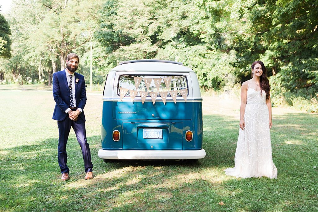 Bride and groom standing next to small vintage just married bus | Balls Falls, Ontario Wedding| Ontario Wedding Photographer| Toronto Wedding Photographer| 3Photography| 3photography.ca