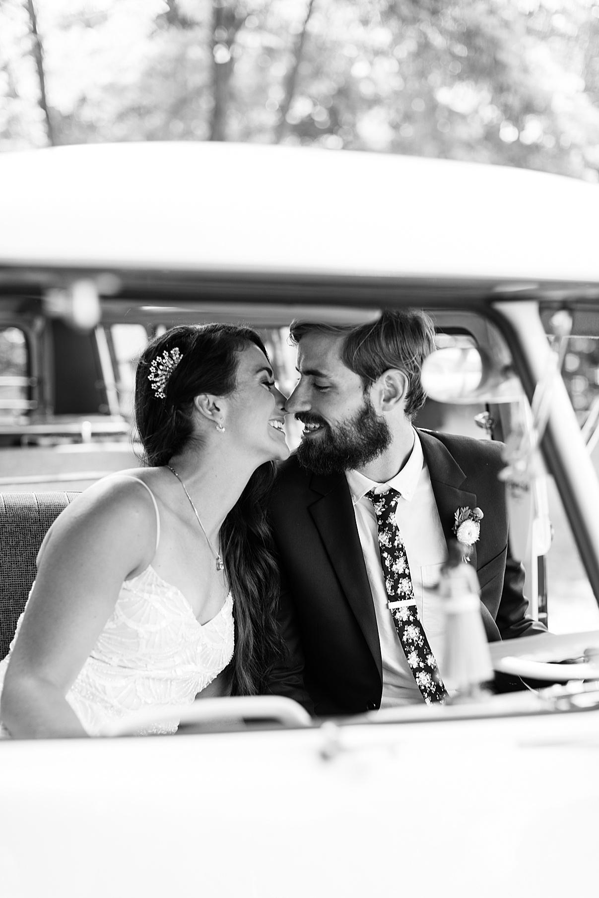 Black and white bride and groom kissing inside vintage bus | Balls Falls, Ontario Wedding| Ontario Wedding Photographer| Toronto Wedding Photographer| 3Photography| 3photography.ca