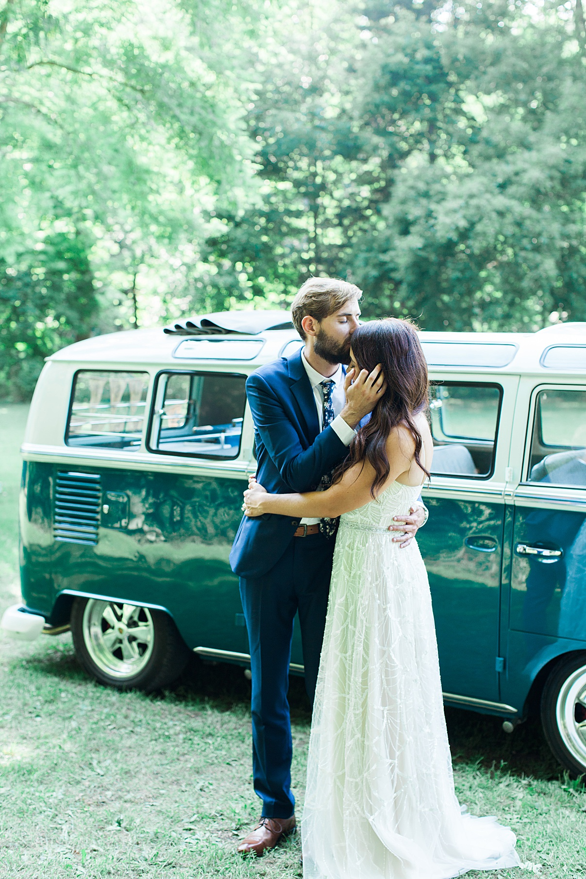 Groom kisses bride on forehead in front of vintage bus| Balls Falls, Ontario Wedding| Ontario Wedding Photographer| Toronto Wedding Photographer| 3Photography| 3photography.ca