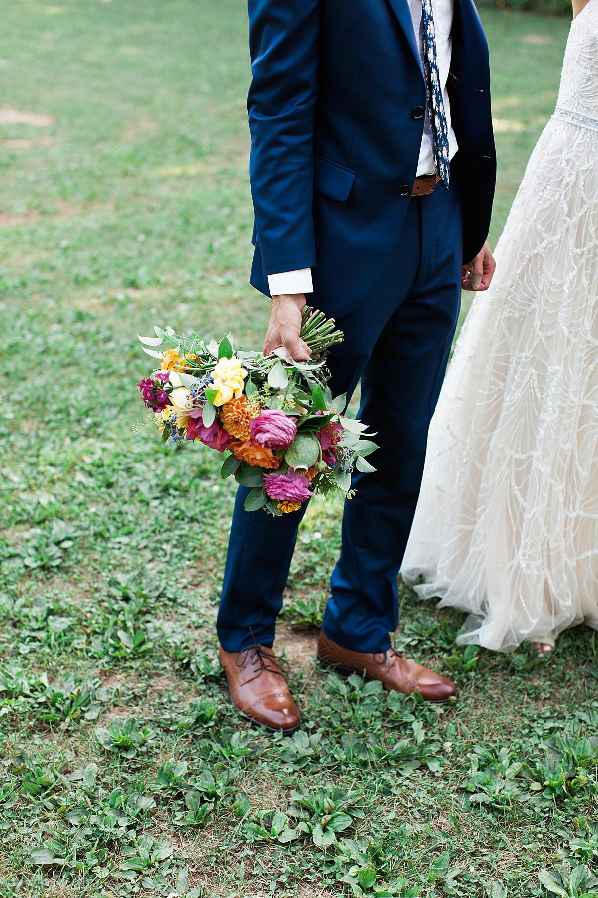 Groom holding bridal bouquet | Balls Falls, Ontario Wedding| Ontario Wedding Photographer| Toronto Wedding Photographer| 3Photography| 3photography.ca