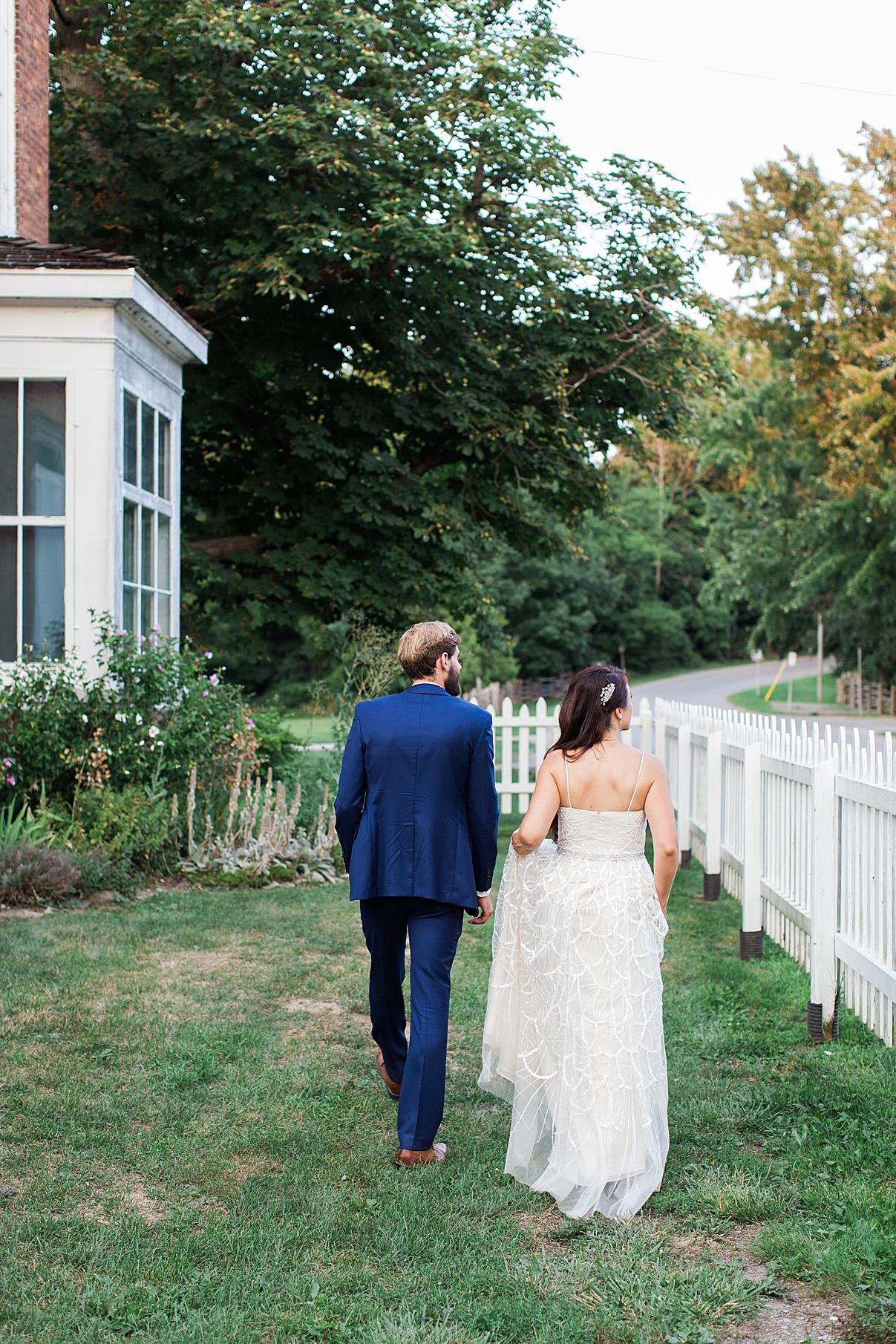 bride and groom walking | Balls Falls, Ontario Wedding| Ontario Wedding Photographer| Toronto Wedding Photographer| 3Photography| 3photography.ca