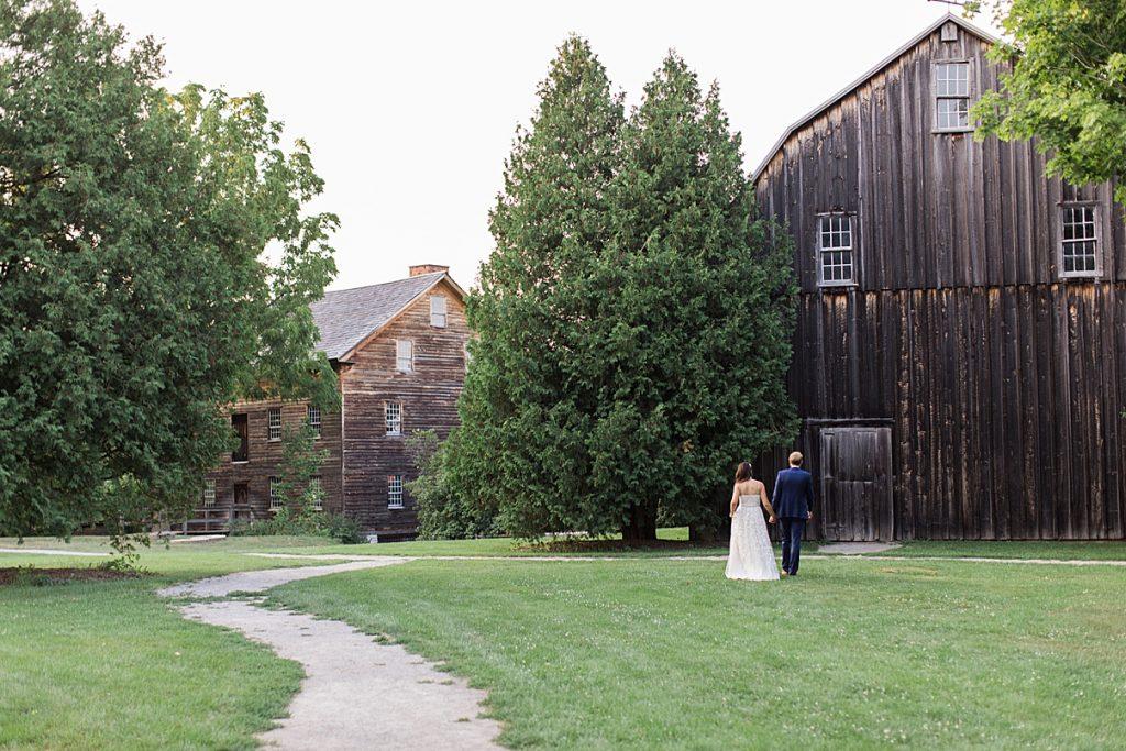Bride and groom walking toward abandoned house| Balls Falls, Ontario Wedding| Ontario Wedding Photographer| Toronto Wedding Photographer| 3Photography| 3photography.ca