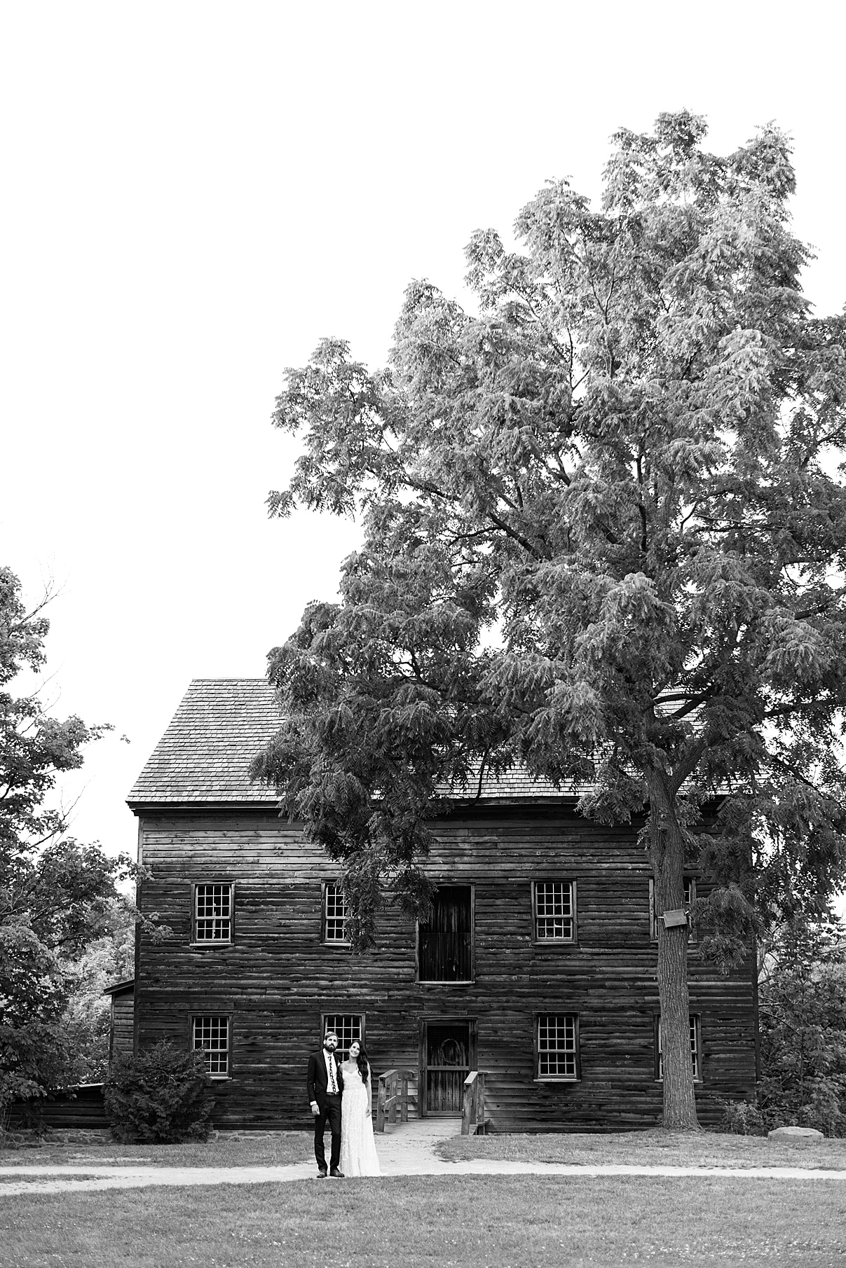 Black and white shot of Bride and groom standing in front of abandoned house| Balls Falls, Ontario Wedding| Ontario Wedding Photographer| Toronto Wedding Photographer| 3Photography| 3photography.ca