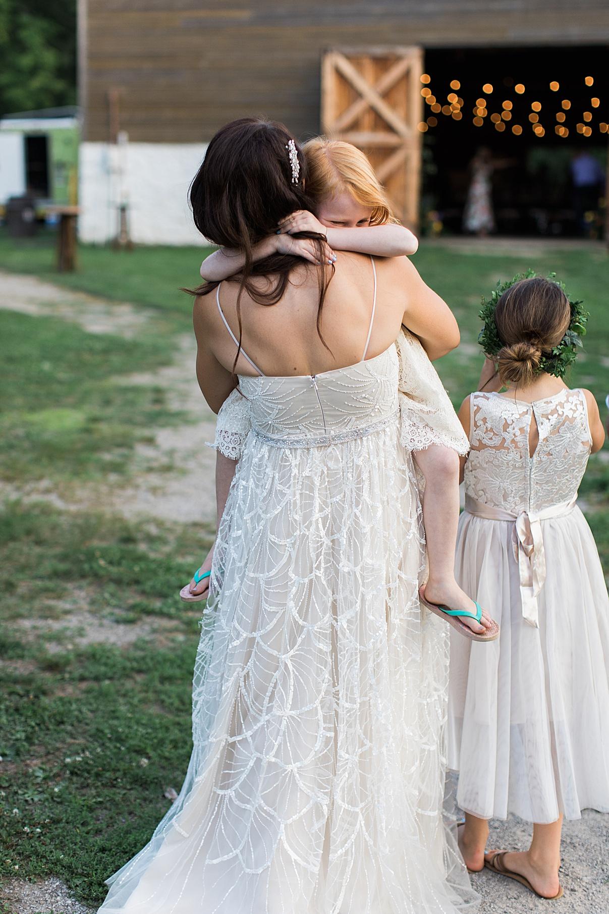 Bride walking while holding flower girl | Balls Falls, Ontario Wedding| Ontario Wedding Photographer| Toronto Wedding Photographer| 3Photography| 3photography.ca