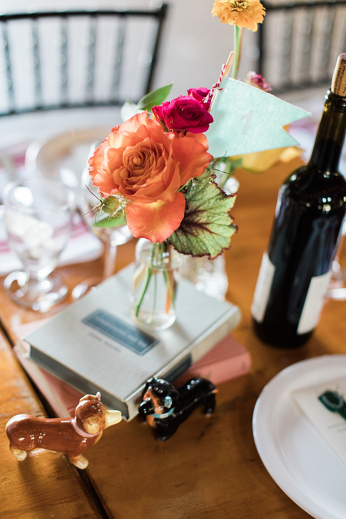 Single flower on book for table setting at reception at Balls Falls, Ontario Wedding| Ontario Wedding Photographer| Toronto Wedding Photographer| 3Photography| 3photography.ca