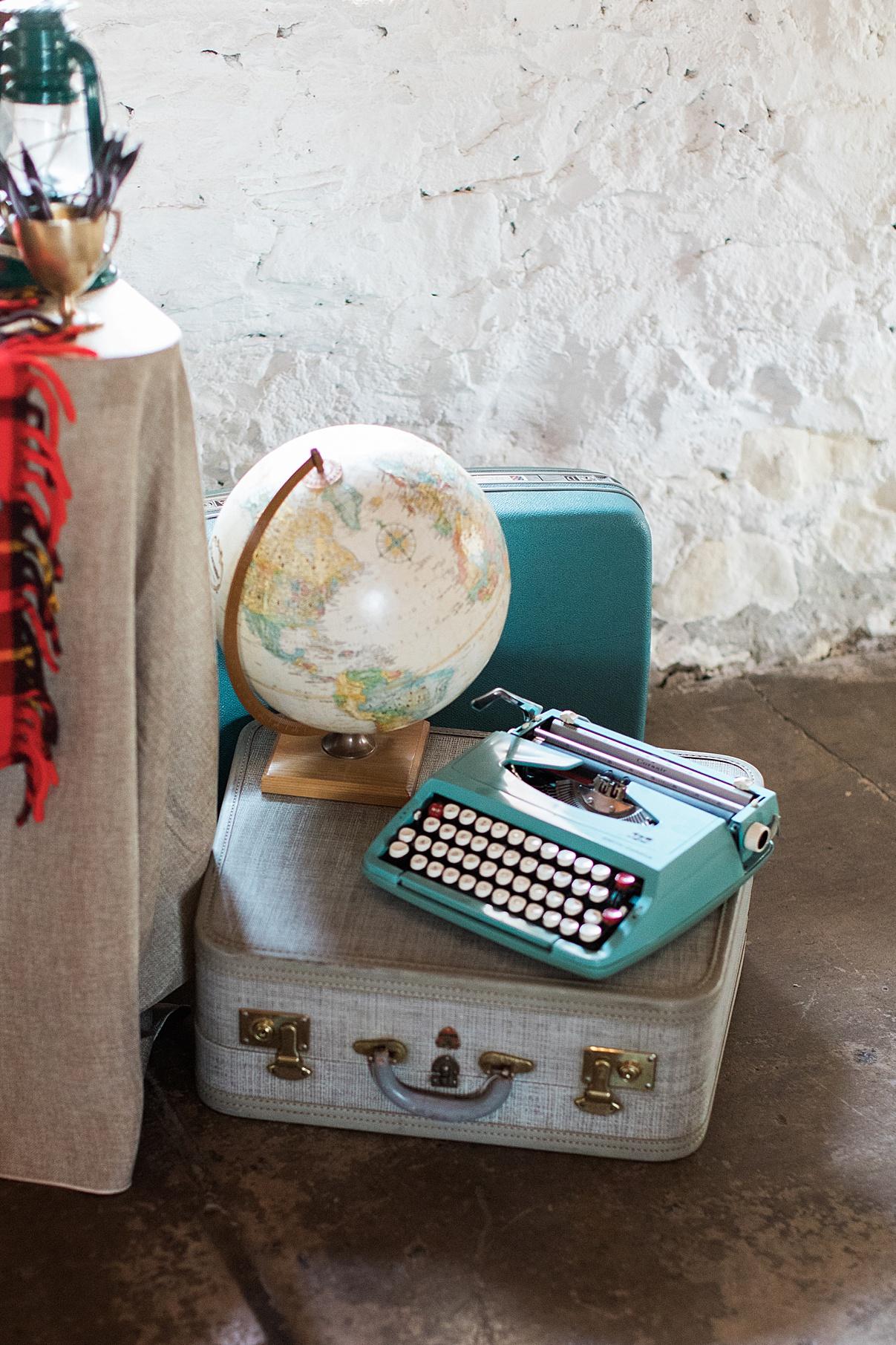 Globe and typewriter sitting on suitcase at wedding reception in Balls Falls, Ontario Wedding| Ontario Wedding Photographer| Toronto Wedding Photographer| 3Photography| 3photography.ca