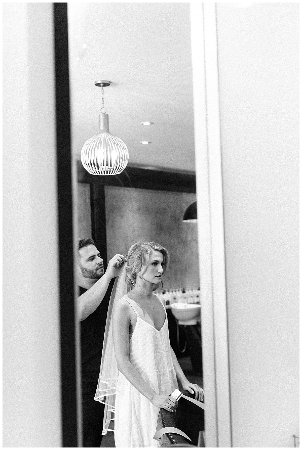 Black & white shot of bride in mirror  3photography