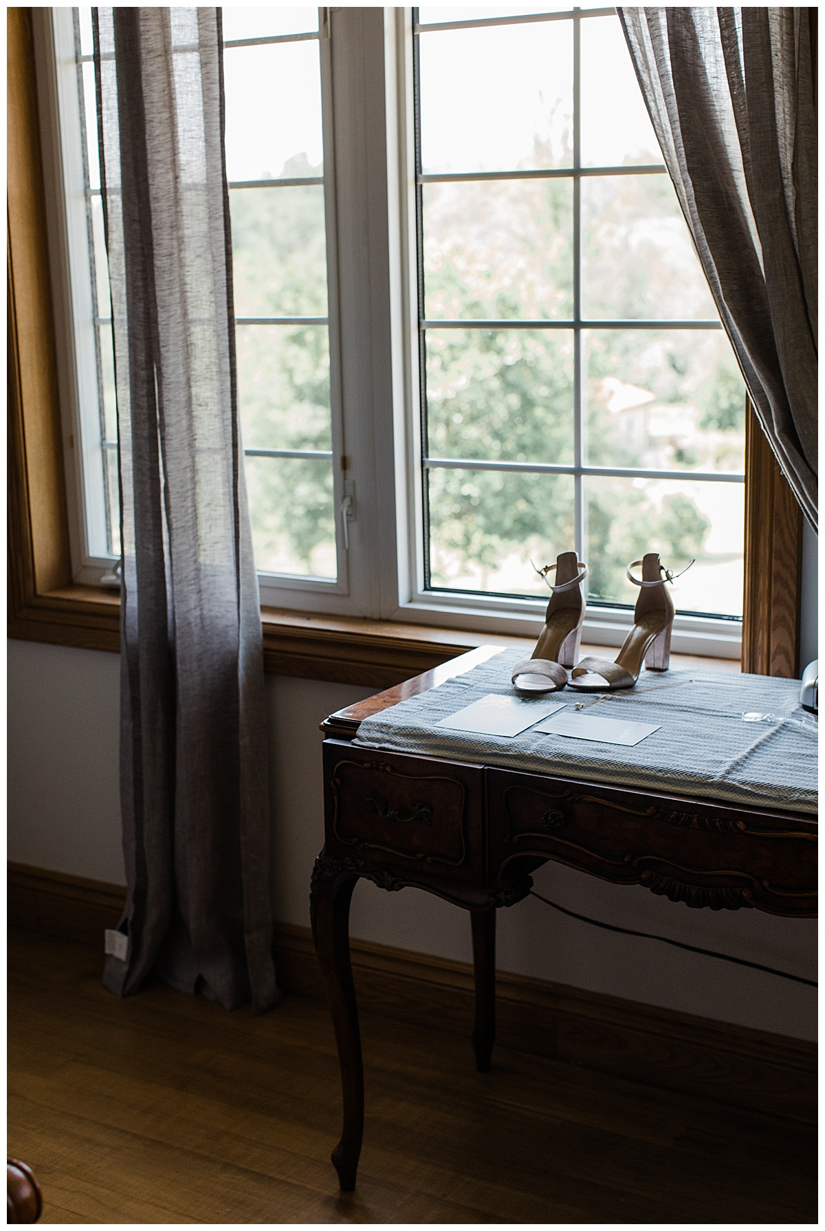Wedding shoes on table in window light  Ontario wedding  Toronto wedding photographer  3photography
