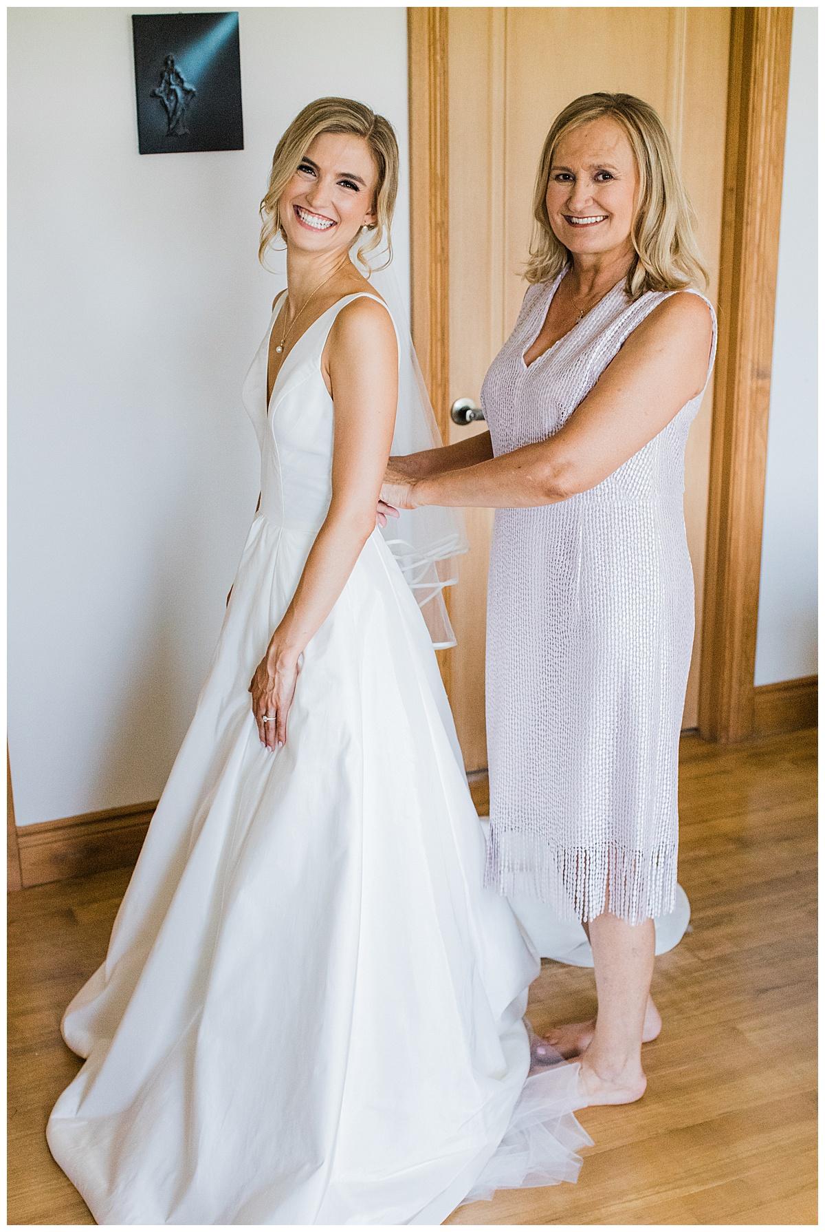 Bride's mother zipping her into her dress  Ontario Wedding  Toronto wedding photography  3photograpy