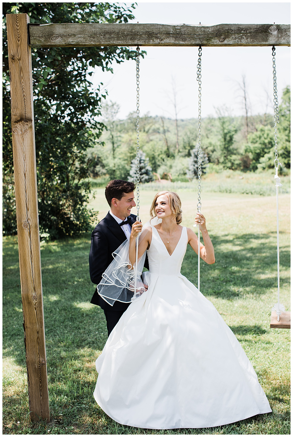Groom smiles at bride while she sits on a swing  Georgetown, Ontario wedding  Toronto wedding photographer  3photography