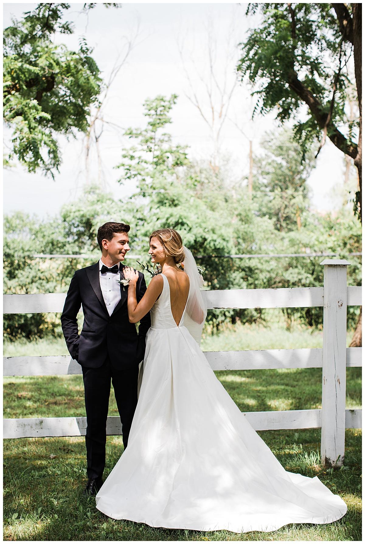 Bride and groom portrait with bride's train running behind her  Ontario wedding  Toronto wedding photographer  3photography
