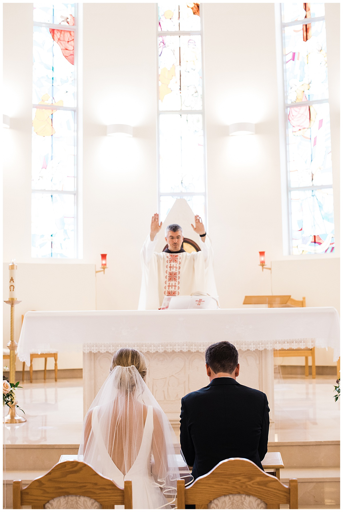 Bride and groom sitting before priest at alter  Georgetown, Ontario wedding  Toronto wedding  3photography
