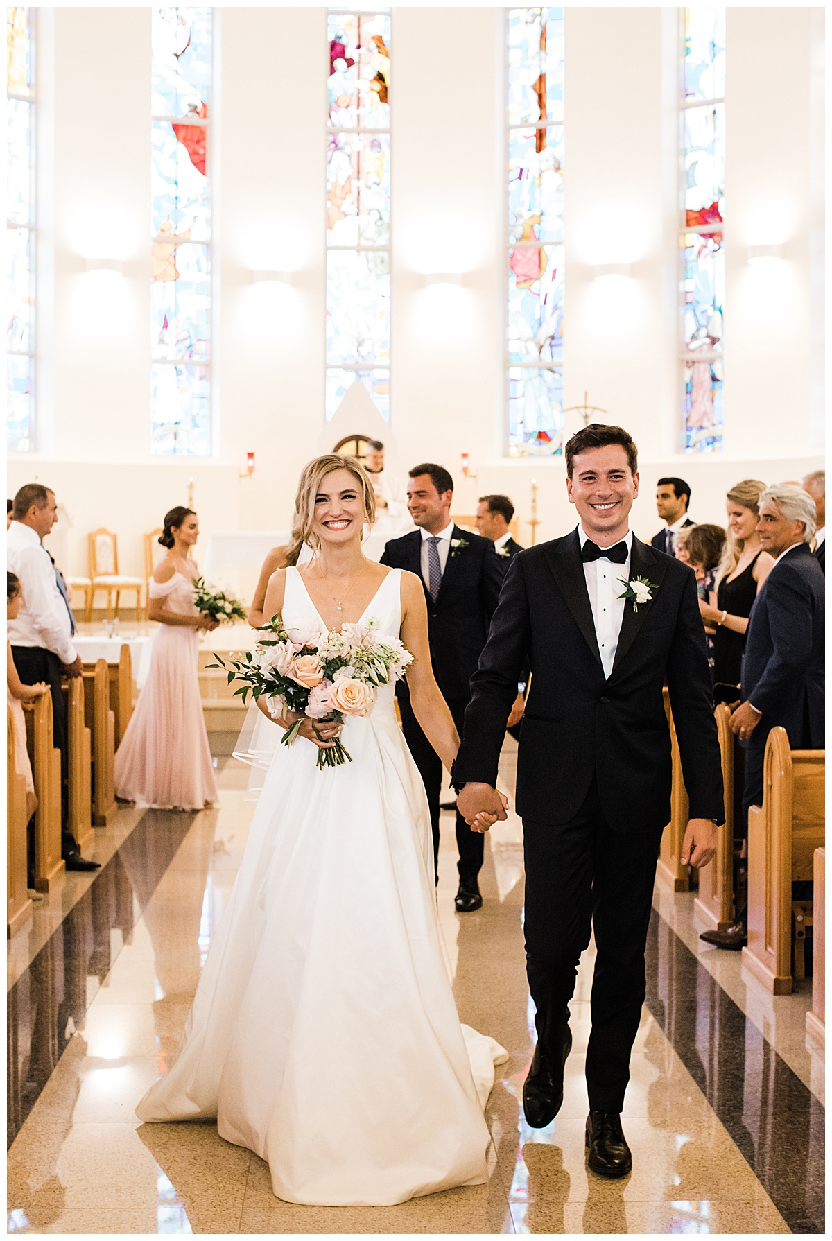 Bride and groom smiling and holding hands while leaving alter  Ontario wedding  3photography