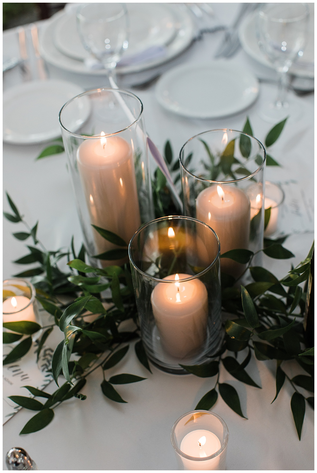 Candle and greenery on wedding reception table  3photography
