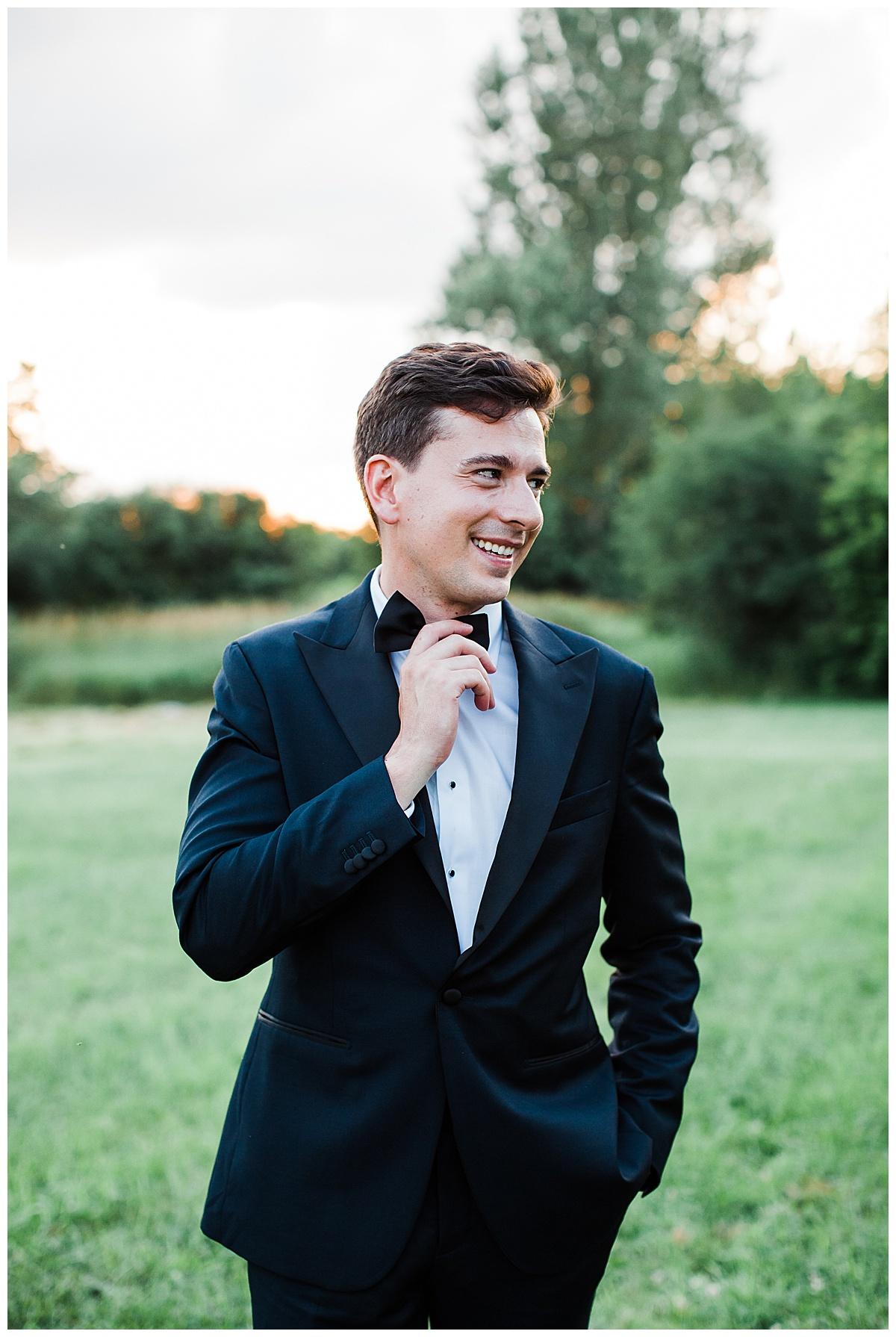 Groom portrait smiling and adjusting his bowtie  Georgetown, Ontario wedding  Toronto wedding photographer  3photography
