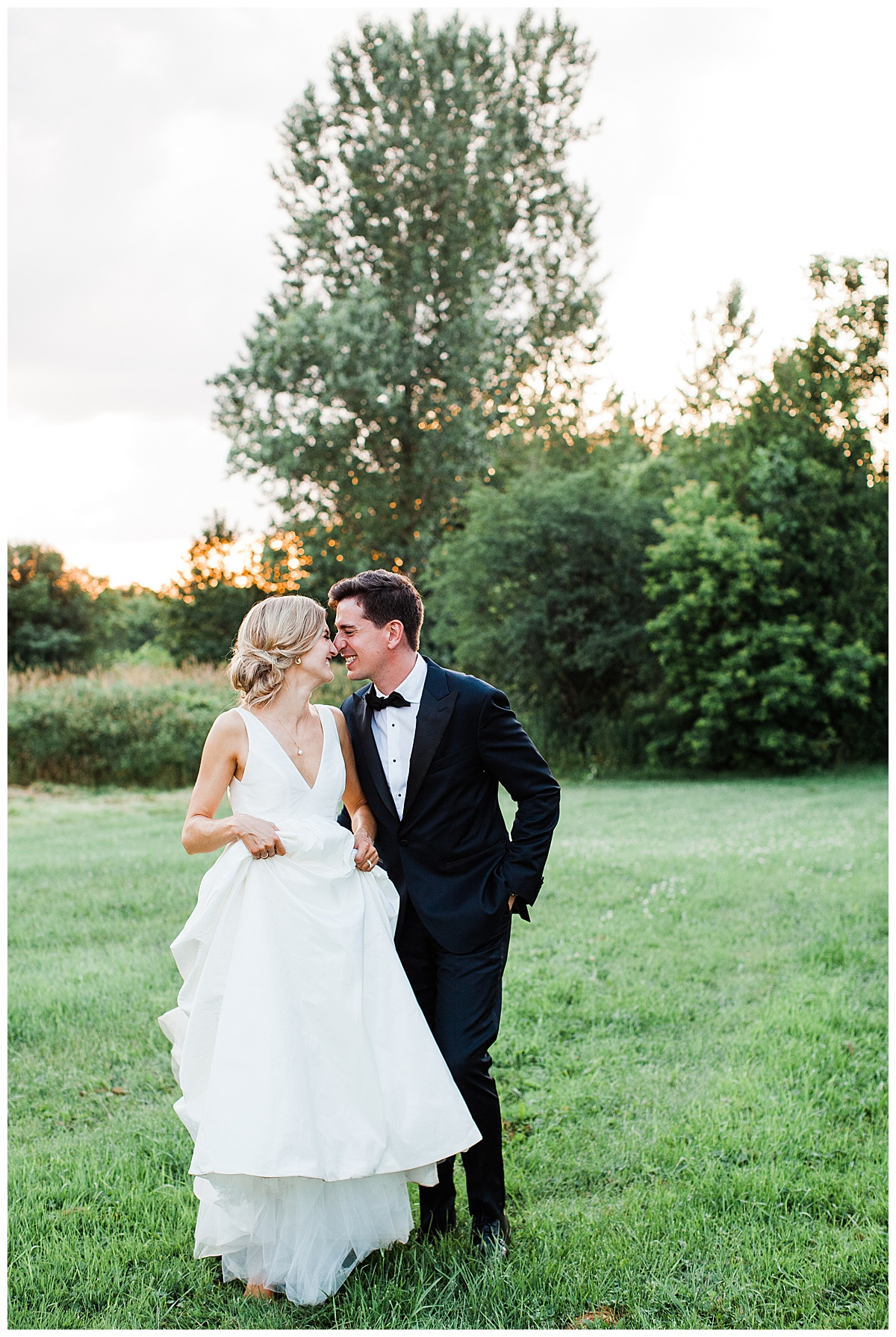 Bride and groom stand in field nuzzling noses at sunset  Ontario wedding  Toronto wedding photographer  3photography