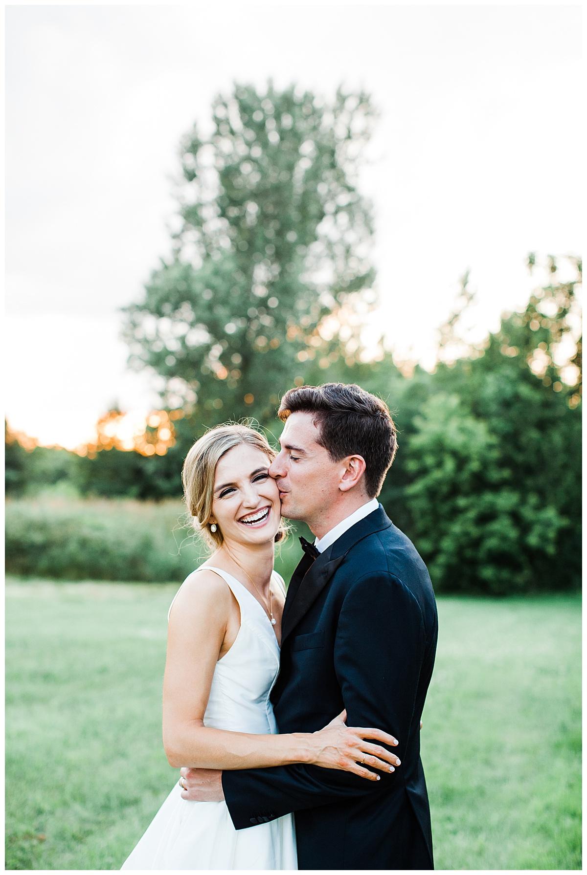 Groom kisses bride on cheek while she laughs| Georgetown, Ontario wedding photographer| Toronto wedding photographer| 3photography