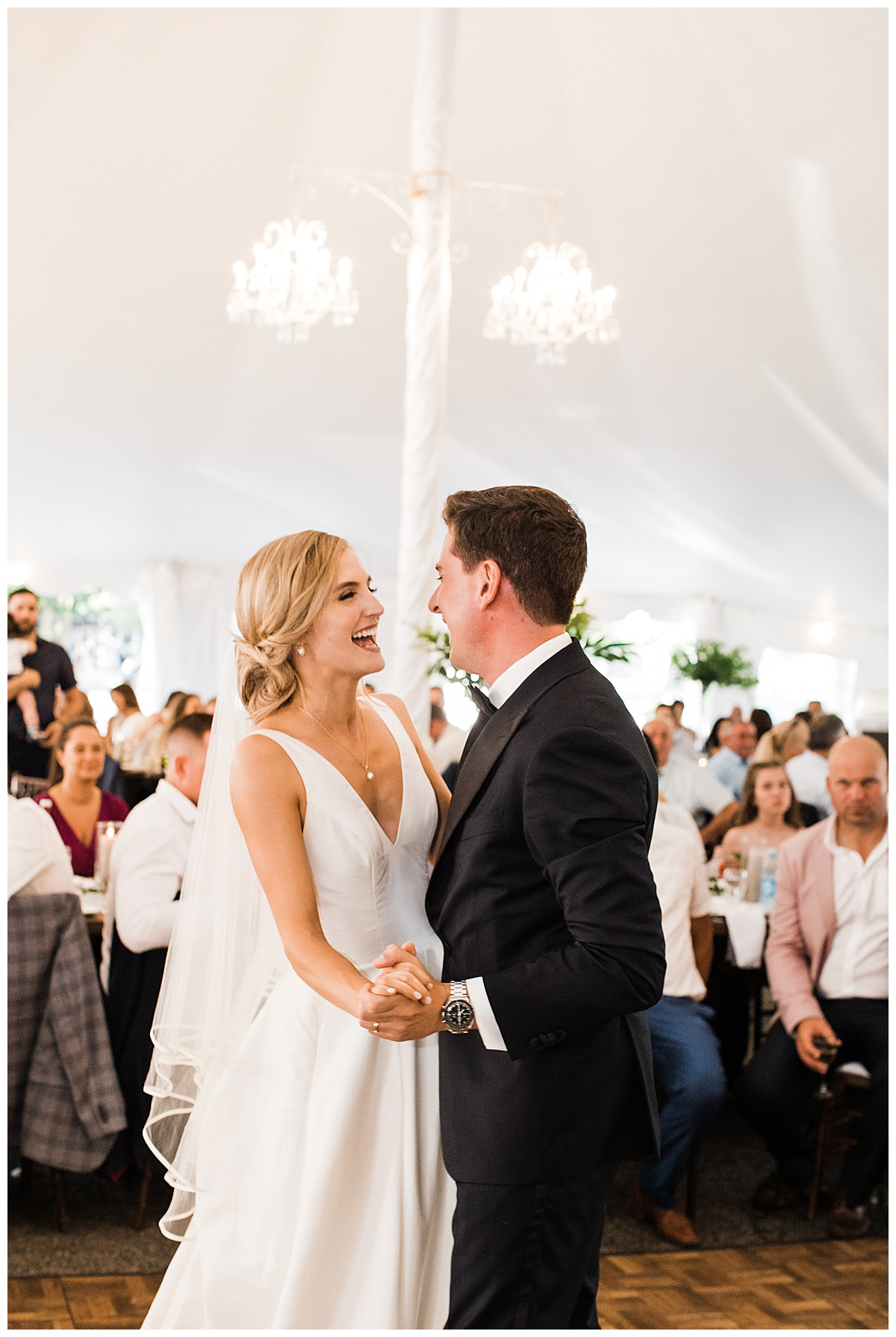 Bride and groom laughing during first dance  Ontario wedding photographer  Toronto wedding photographer  3photography