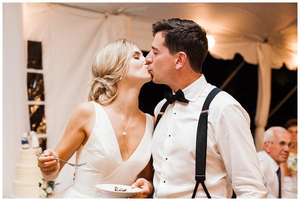 Bride and groom kiss after eating wedding cake  Ontario wedding  Toronto wedding photographer  3photography