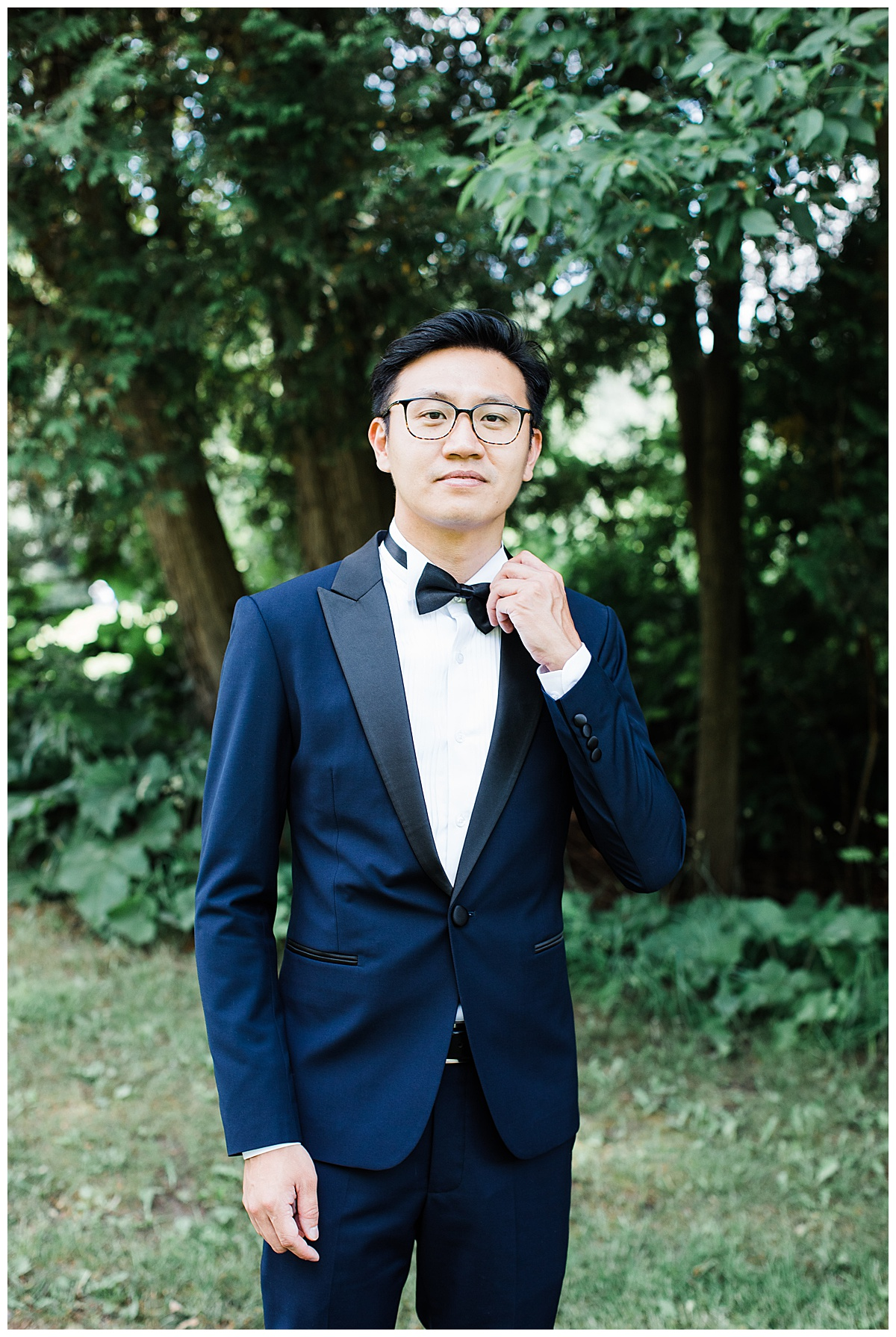 Asian groom stands in blue tux awaiting his bride for first look| Adamo Estate Winery wedding| 3photography