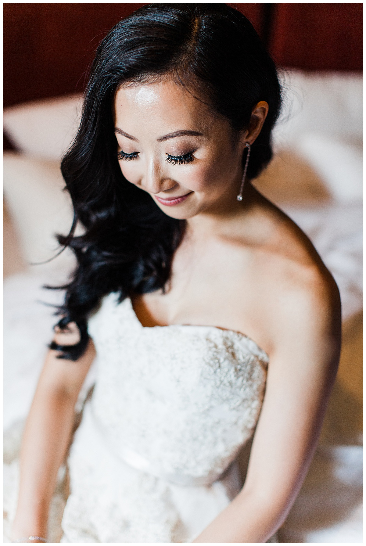 Bride looking down showing off bridal makeup and tear drop earring| winery wedding| Asian bride| Toronto photographer| 3photography