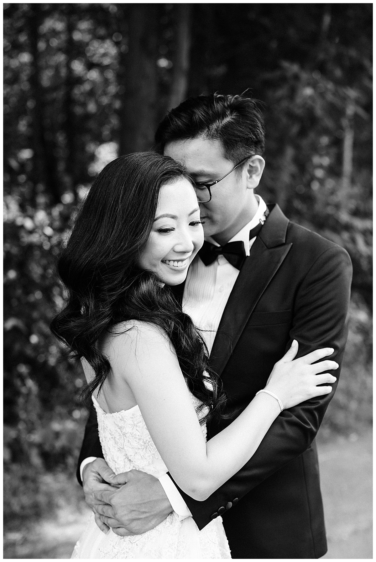 Black and white of groom nuzzling bride while she looks down| asian bride| bride and groom portraits| winery wedding| Toronto photographer| 3photography