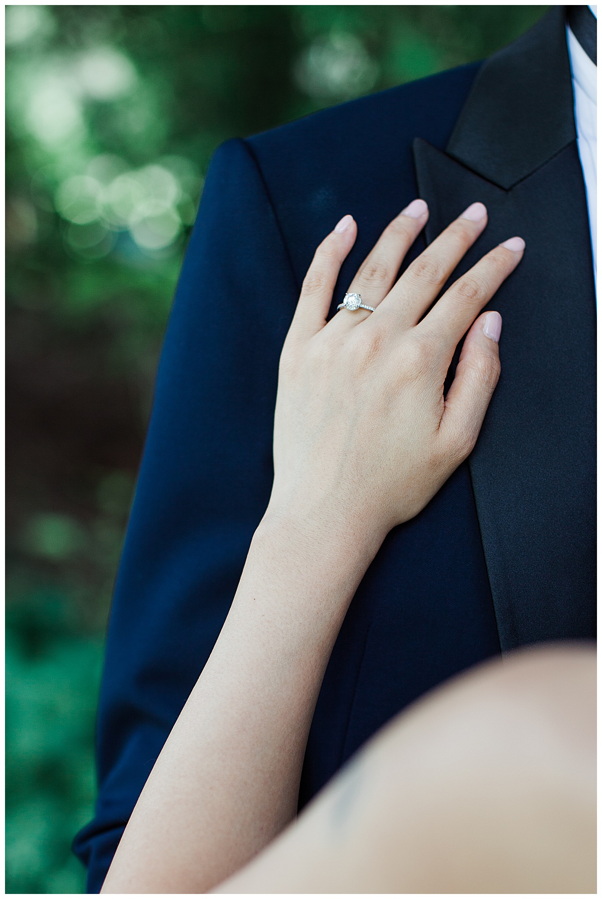 Bride's hand resting on groom's chest showing off her wedding ring| solitaire wedding ring| bride and groom portrait| winery wedding| Adamo Estate Winery wedding| Toronto photographer| 3photography