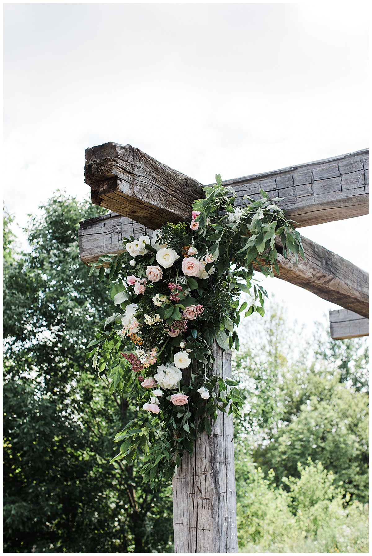 Floral detail on corner of wedding arch at Adamo Estate Winery wedding| Toronto photographer| 3photography